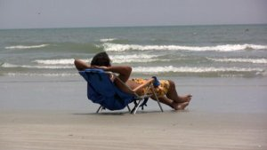 stock-footage-guy-in-beach-chair